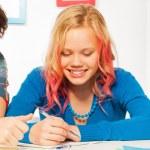 Boys help girl do homework — Stock Photo #77367676