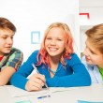 Cute girl and boys do homework — Stock Photo #77367758