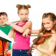 Group of children playing musical instruments — Stock Photo #77369056