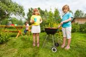Two girls near grill — Stock Photo