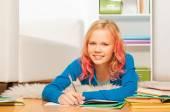 Smart blond girl does homework — Stock fotografie