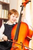 Happy girl playing cello — Stock Photo