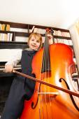 Girl in dress playing cello — Stock Photo