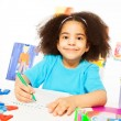 Cute African girl writing letters — Stock Photo #77371684