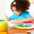 Small girl writing letters — Stock Photo #77371732