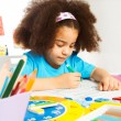 Small African girl writing letters — Stock Photo #77371740