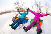 Children sliding down on tubes — 图库照片
