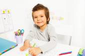 Small boy draws with pencil — Stock Photo