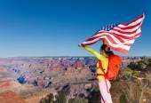 Woman holding US flag — Stock fotografie
