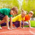 Three kids ready to run — Stock Photo #77383228
