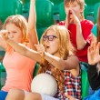 Teenagers cheer for team during game — Stock Photo #77384932