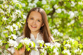 Teenager girl with white flowers — Stock Photo