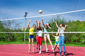 Teenagers team actively playing volleyball — Stock Photo