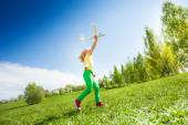 Girl running and holding airplane — Fotografia Stock