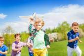 Happy running children with airplane toy — Stock Photo
