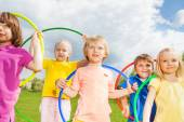 Children holding hula hoops in park — Photo