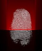 Thumb print scanning with red laser beam — Stock Photo