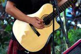 Street performer playing guitar — Stock Photo