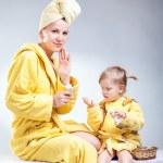 Daughter and mother putting makeup — Stock Photo #70341897