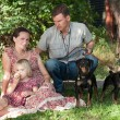 The man with two dogs protects the woman with the child — Stock Photo #52172557