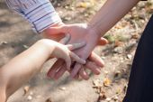 Hands of adults and child — Stock Photo