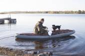 The hunter with a dog sail on hunting — Stock Photo