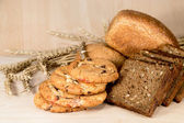White black bread and cookies with grain — Stock Photo