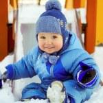 Joyful kid on children playground in winter — Stock Photo #57174025