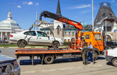 Loading of automobile car on wrecker for parking infringement in — Stock Photo