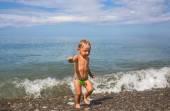 Little boy leaves sea — Stock Photo