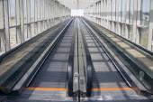 Tape escalator in glazed tunnel — Stock Photo