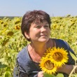 Woman with sunflowers — Stock Photo #70847017