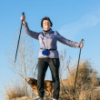 Happy woman with sticks for walking — Stock Photo #71116909
