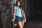 Teen girl with skate board. Outdoors, urban lifestyle. — Stock Photo
