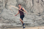 Sporty man jumping rope outdoors — Stock Photo