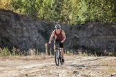 Athlete man cycling on a bicycle — Stock Photo