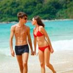 Happy couple in sunglasses on the beach — Stock Photo #61601447