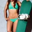 Woman wearing bikini and holding snowboard — Stock Photo #66860263