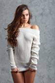 Beautiful young brunette woman in sweater — Stock Photo
