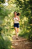 Woman running in the park — Stock Photo