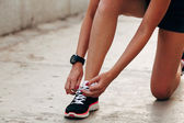 Runner woman tying laces closeup — Stock Photo