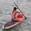 Woman on a Paddle Board — Stock Photo #53728973