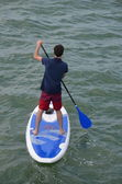 Young Man on a Blue and White Paddle Board — Stock Photo