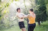 Young couple in garden — Stock Photo