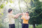 Young couple in garden — Foto de Stock