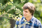 Handsome man in garden — Stock Photo