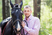 Handsome man and horse — Stockfoto