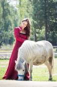Brunette girl and horse — Stock Photo