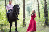 Man on horse and girl — Stock Photo