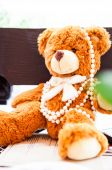 Fluffy toy bear with pearls — Fotografia Stock